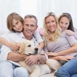 Family on couch with dog in pet friendly apartment in Northern Virginia