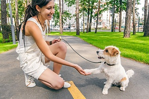 Woman and dog training on leash